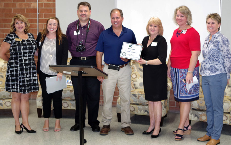 Tracy Hall (CVCC Education Matters), Meaghan Lewis (NC Chamber), Gary Herman (Alexander County EDC), Ryan Mayberry (Alexander County Commission Chairman), Linda Graham (CVCC Alexander Center for Education), Susan Gantt (Alexander County Schools), and Wendy Johnson (WPCOG) accept the Certified Work Ready Community certificate at the 9/30/16 ceremony.